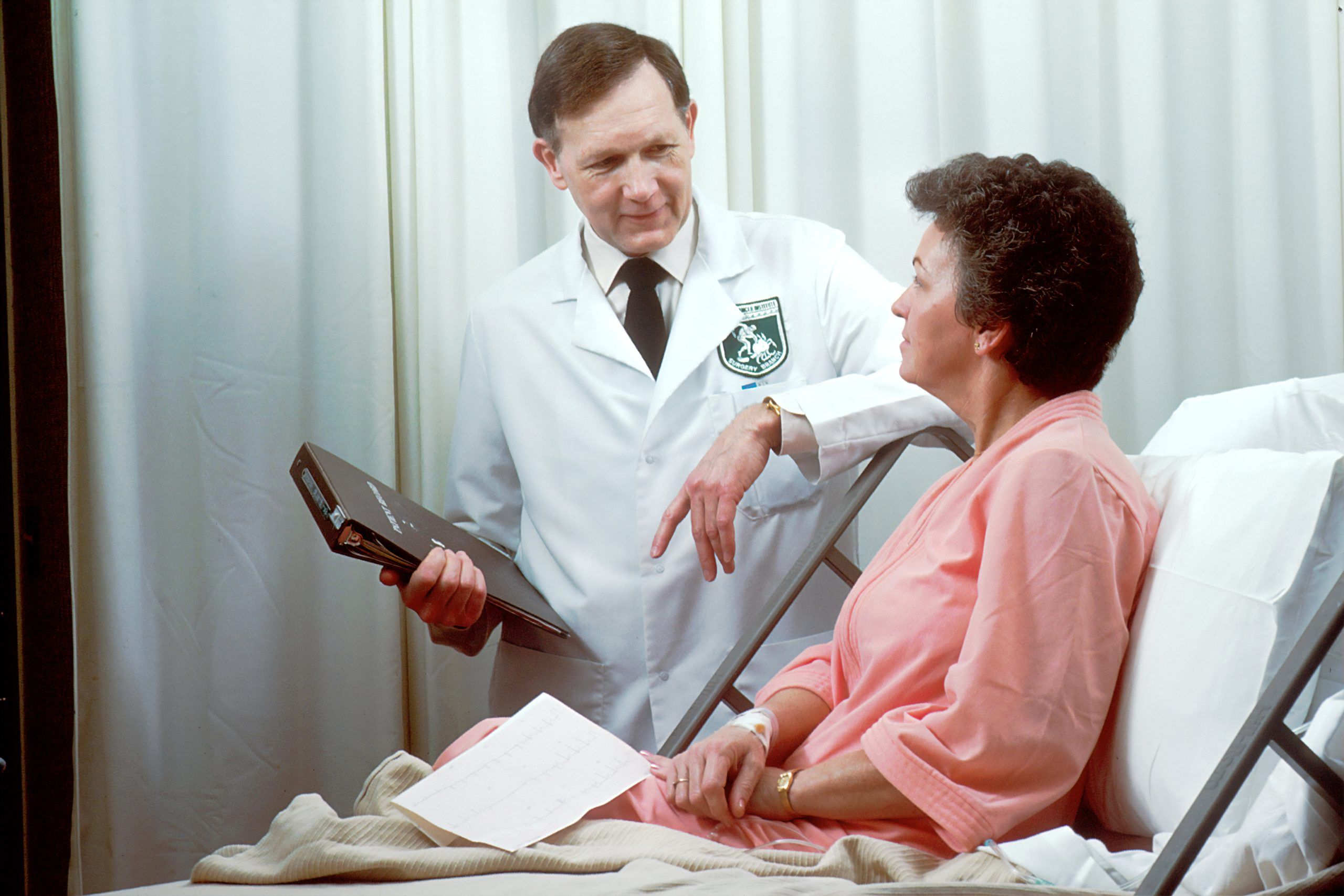 Doctor doing an annual wellness visit with a patient